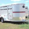 "All Alum       ALUMINUM CATTLE TRAILER         14' OR 16' 6' OR 7' WIDE        STANDARD EQUIPMENT: 6'6"" TALL, SOLID SIDES WITH TWO OPENINGS ABOVE, CENTER GATE, FULL SWING HALF SLIDING REAR GATE, CHROME CIRCLE VENT EACH SIDE, RUBBER MOUNT 8X18 WINDOW IN FRONT, SIDE ACCESS DOOR ON RIGHT, SPARE RACK, CHROME GRAVEL GUARD, CHROME TRIM WITH COLORED VINYL INSERT, RUBBER BUMPER, LICENSE PLATE LIGHT    OPTIONAL EQUIPMENT: 7' TALL, EXTRA ACCESS DOOR, SLIDING CENTER GATE, FLOOR MATS, DOME LIGHT, COLOR ACCENT TAPE, SPARE TIRE & WHEEL"