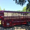"Hard top Bullet Nose with Calf pen, 6'8""x24' 2-7k torsion axles, rubber floor, walk out door, 14 ply tires, 1'x3"" square tubing sides, 2-cut gates, trailer is on re-order in dark shadow grey"